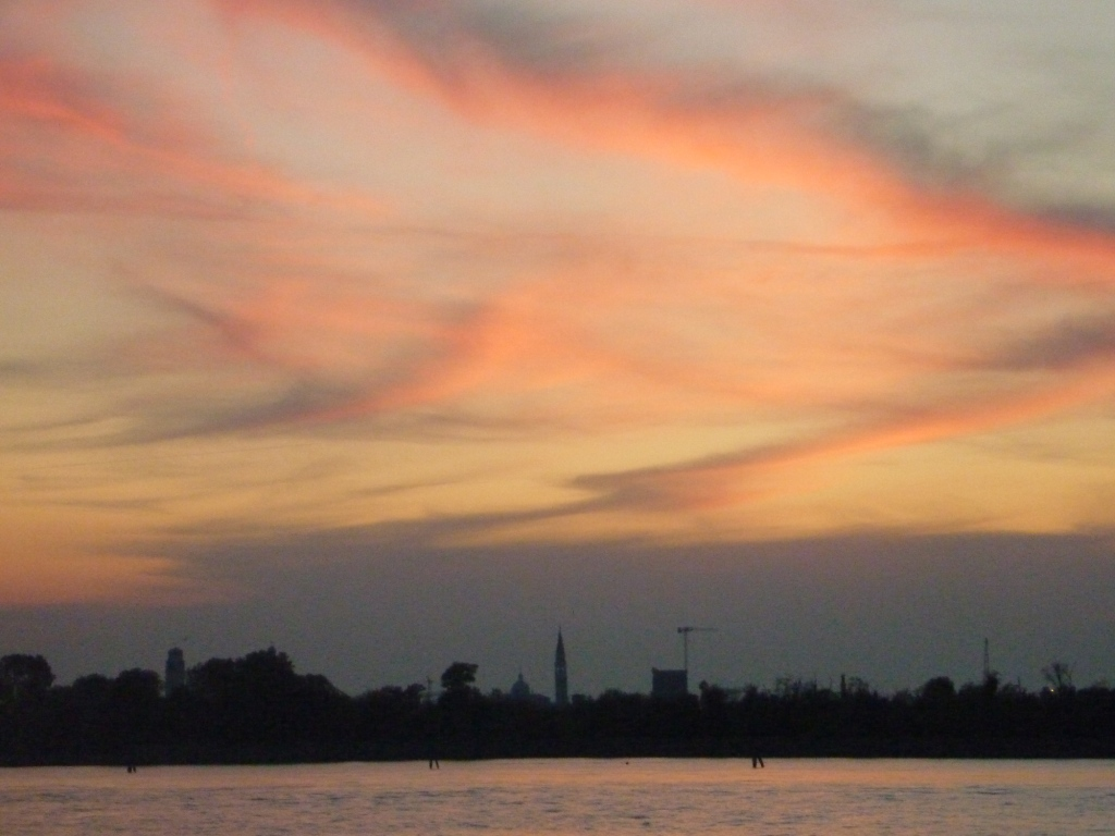 The sunset over Venice, seen from the Lido after our return